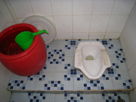 squat toilet with bucket
